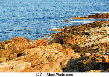 Rocky shore of Atlantic ocean in Maine, United States