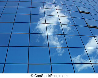 Window panels on a office building in the city with...