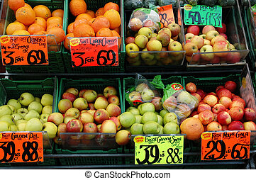 fruitshop - Shot of a fruit shop display Oranges, apples and...