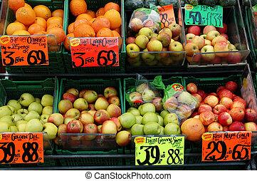 fruitshop - Shot of a fruit shop display. Oranges, apples...