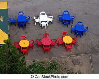 Tables and chair - Varicoloured tables and chair of summer...