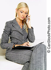 Businesswoman - Young business woman talking by phone