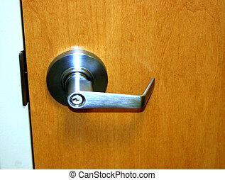 Door handle - Grey, metal door handle on fake wooden door...