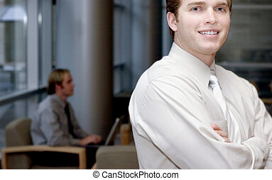 Business man pose - Young business man smiling looking...