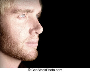 Man in thought - Blond hair blue eye man looking off into...