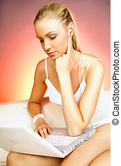 Girl with laptop - Portrait of a young woman working on...