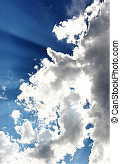 Rays in Cloud - Rays of Sun beaming through clouds in the...