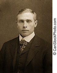 ryan - antique photograph of man in suit tie and vest