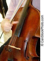 Cello - Man is playing a cello.