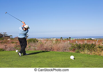 Golfers 61 - A golfer playing golf on a green Movement on...