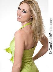 Smiling girl glances over shoulder - Smiling confident...