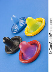 Funny Condoms - Colour condoms on the blue background