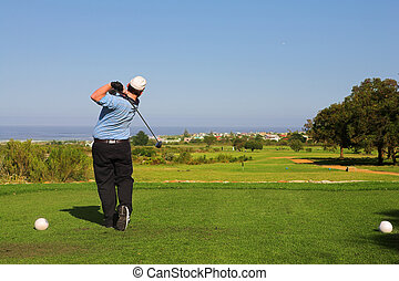 Golfer 62 - A golfer playing golf on a green Movement on...