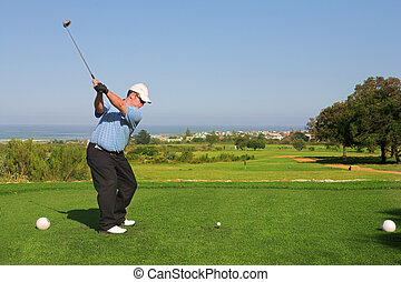 Golfer 65 - A golfer playing golf on a green Movement on the...
