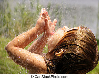 Playing in the rain - Child playing in the rain