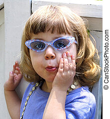 Girl in sunglasses - Little girl wearing sunglasses and...