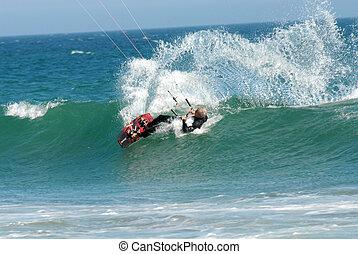 Kitesurfer - kitesurfer carving a wave