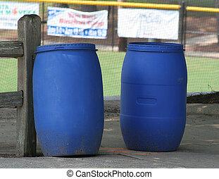 Blue Barrels - Blue plastic trash barrels