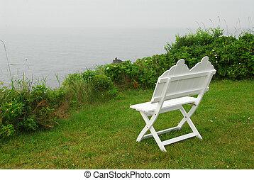 Bench on ocean shore