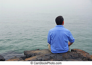 Man looking at fog - Man looking at the foggy ocean...