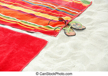 Beach towels on sand - Colorful beach towels on sandy beach