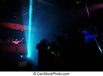 Clubbers at night - Club shadow play Motion blurred DJ...