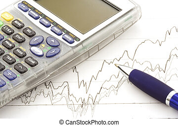 Stock chart, calculator and blue pen