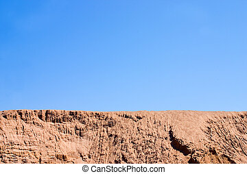 Desert landscape. A heap of sand on a building site