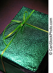 Gift In A Box - A gift wrapped in green textured paper and...