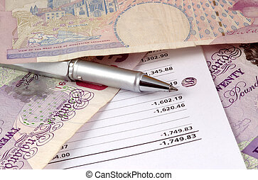 Pen and pounds - mixture of pen, pounds and statement
