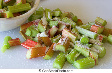 Rhubarb - Diced rhubarb sprinkled with sugar on cutting matt...