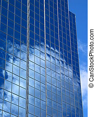 Bright Outlook - sky reflected in windows of modern office...
