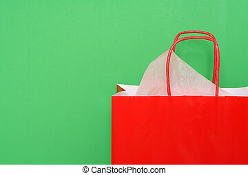 Shopping bag - Red shopping bag on green background
