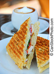 Grilled sandwich - Grilled chicken sandwich and a cup of...