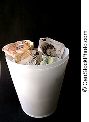 Money Rubbish - Rubbish bin to show throwing money away due...