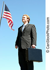 American Business Man - Business man in black suit carrying...