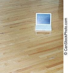 white laptop wood floors - White laptop on wooden floors