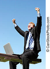 Business celebration - Business man celebrating as he gets...
