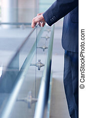 Holding the glass wall - Business man holding the glass wall...