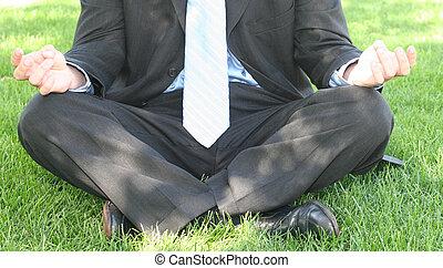 Business zen - Business man in black suit is meditating in...