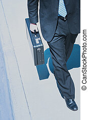 Business power walk - Business man in black suit and holding...