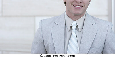Business smile 3 - Business man in tan suit, tan shirt, and...