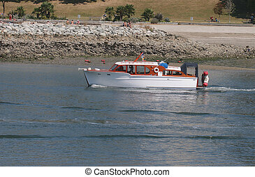 Cabin cruiser - boat leaving vancouver harbour