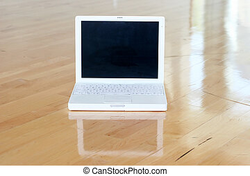 laptop 5 - White laptop with black screen on wooden floor