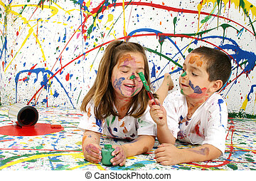 Paint Children - Adorable boy and girl covered in paint...