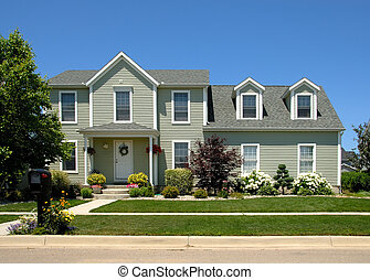 House in Summer - Two story vinyl siding house in the...