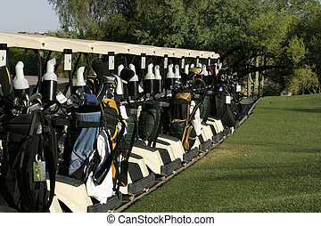 Golf Carts Ready - A row of golf carts are lined up at the...
