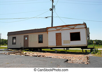 Trailer Home - A trailer home, in a state of disrepair, out...