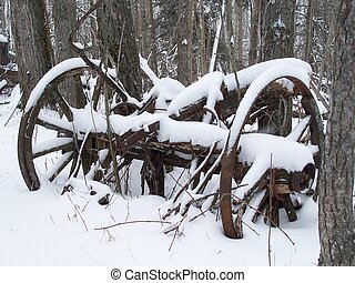 Old wagon - Remains of an old wagon buried under snow