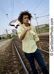 playing guitar09 - cool guy with his guitar at a train...